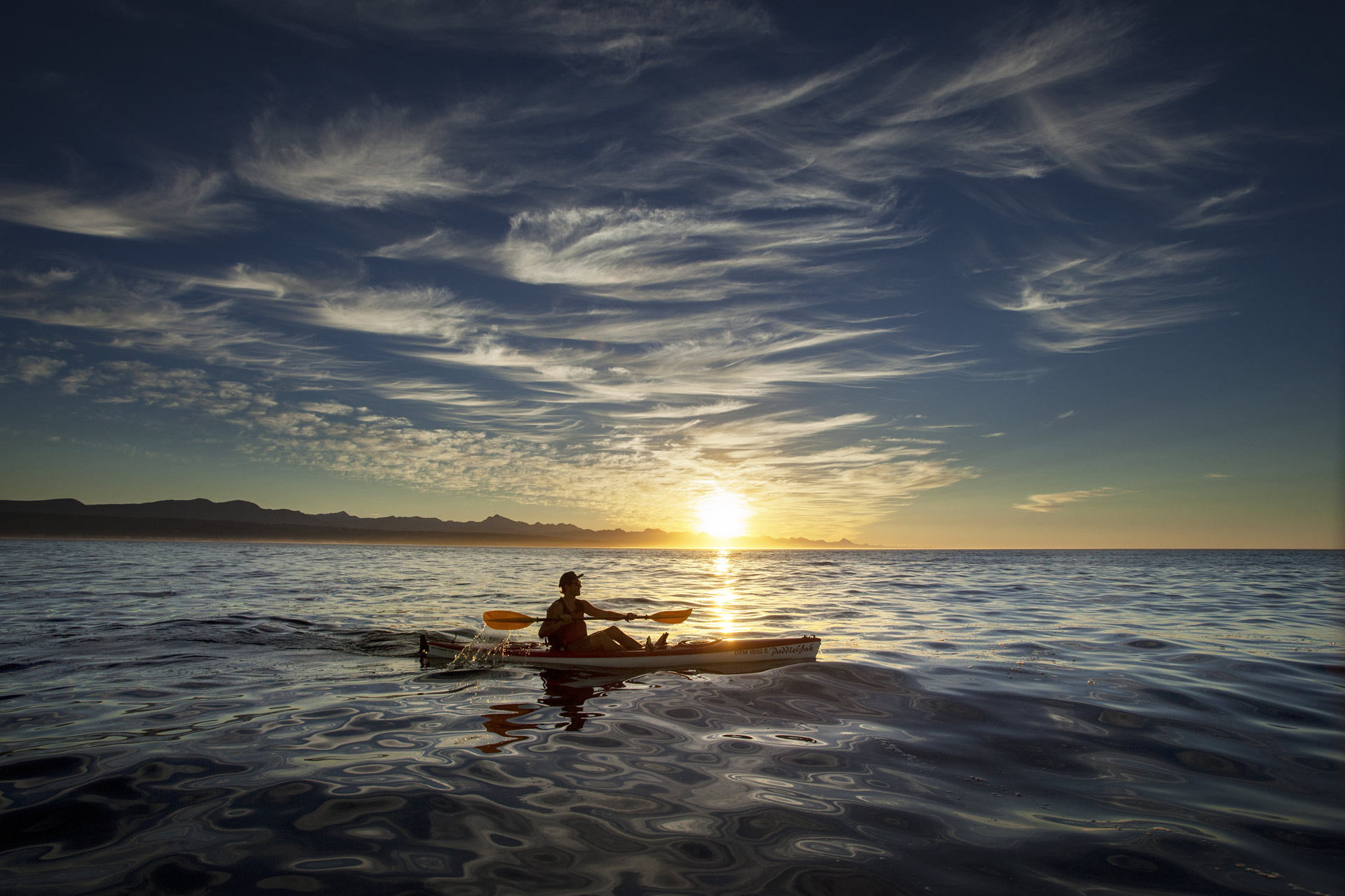 Paddling a kayak on the sea at Plett