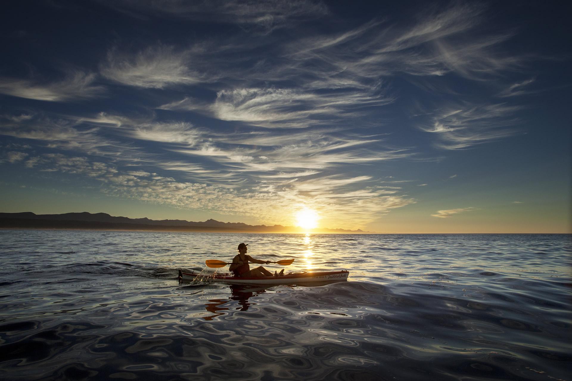 Paddling a kayak on the sea at Plett
