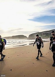 Members of a team from Expedition Africa make their way across the beach to 'The Island' off Robberg in Plettenberg Bay