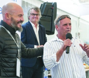 VINE SURFER: Winemaker Anton Smal masters the mic at this year's Wine & Bubbly Festival, with 'Greener Surfer' John McCarthy at left and Plett Tourism CEO Peter Wallington smiling on at back