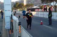 Jessica Kam Kam crosses the finish line at the Knysna Oyster Festival 5km run