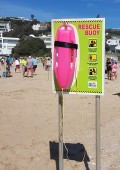 Pink torpedo buoys at beaches in Plett