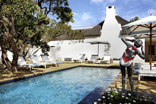 The pool and deck at The Old Rectory have been built around the centuries-old milkwood trees.  Image: Rare Earth