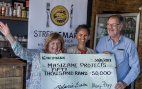 Brenda Wall and Mike Scholtz (Masizame) on either side of and Melanie Burke (Chairman, StreetSmart SA)