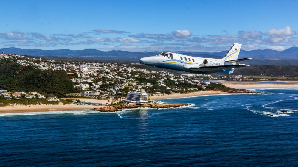 Plett Air Safaris plane over BI hotel in Plett