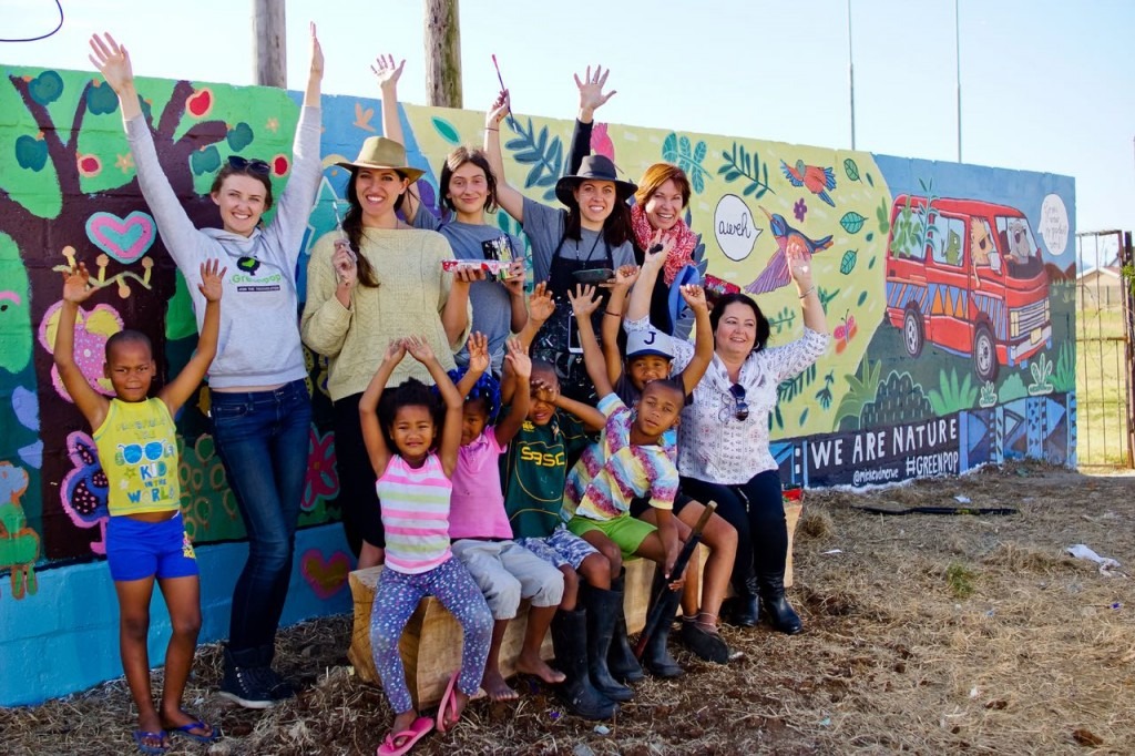 Week 3 - participants and children from Seven Passes Initiative painting the Touws Ranten mural