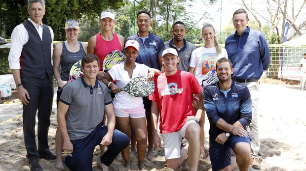 David Sieff, KIA Motors SA marketing director (back far left) and Richard Glover, Tennis South Africa CEO (back far right) with SA wheelchair tennis players and celebs at the launch of the Beach Tennis sponsorship in Sandton on Wednesday. Photo: The PR Machine