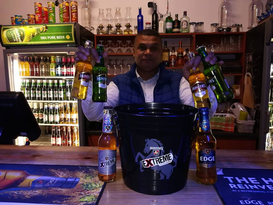 Owner Shaun behind the bar at N2 Lounge and Sports Bar in Kwanokuthula, Plett