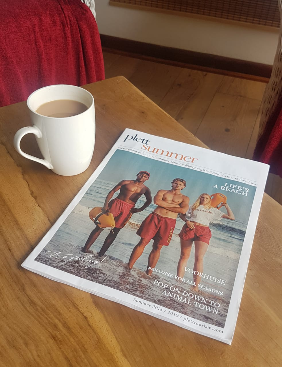 plett summer 2018 mag on coffee table