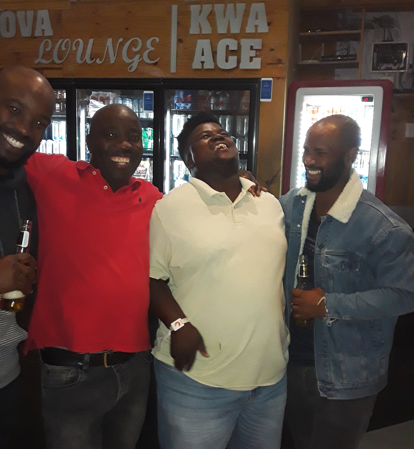 Plett locals sightseeing at a popular lounge (Kwa Ace) in Khayelitsha after the jazz Festival. From left to right: Athi, James, Wandisile and Sethu.