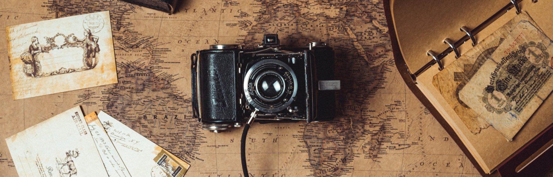Camera, map and notes for your itinerary
