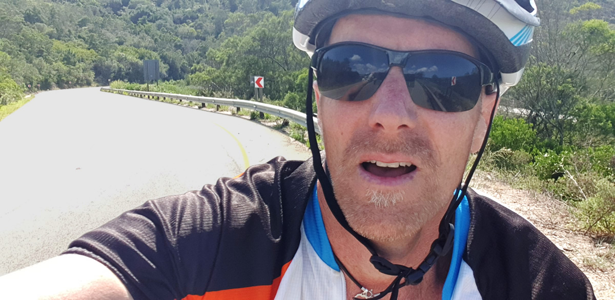 Brendon Morris cycling up Piesang Valley Road hill training for Cape Town Cycle Tour - Lunchbox Theatre raise funds for education of children of Plett.