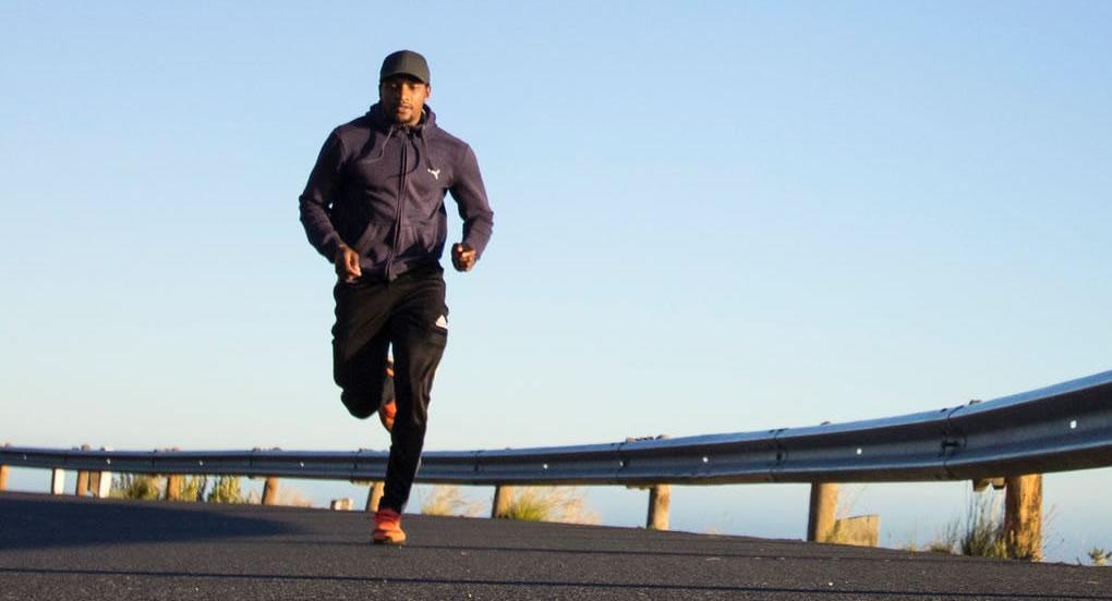 jogger on tar road