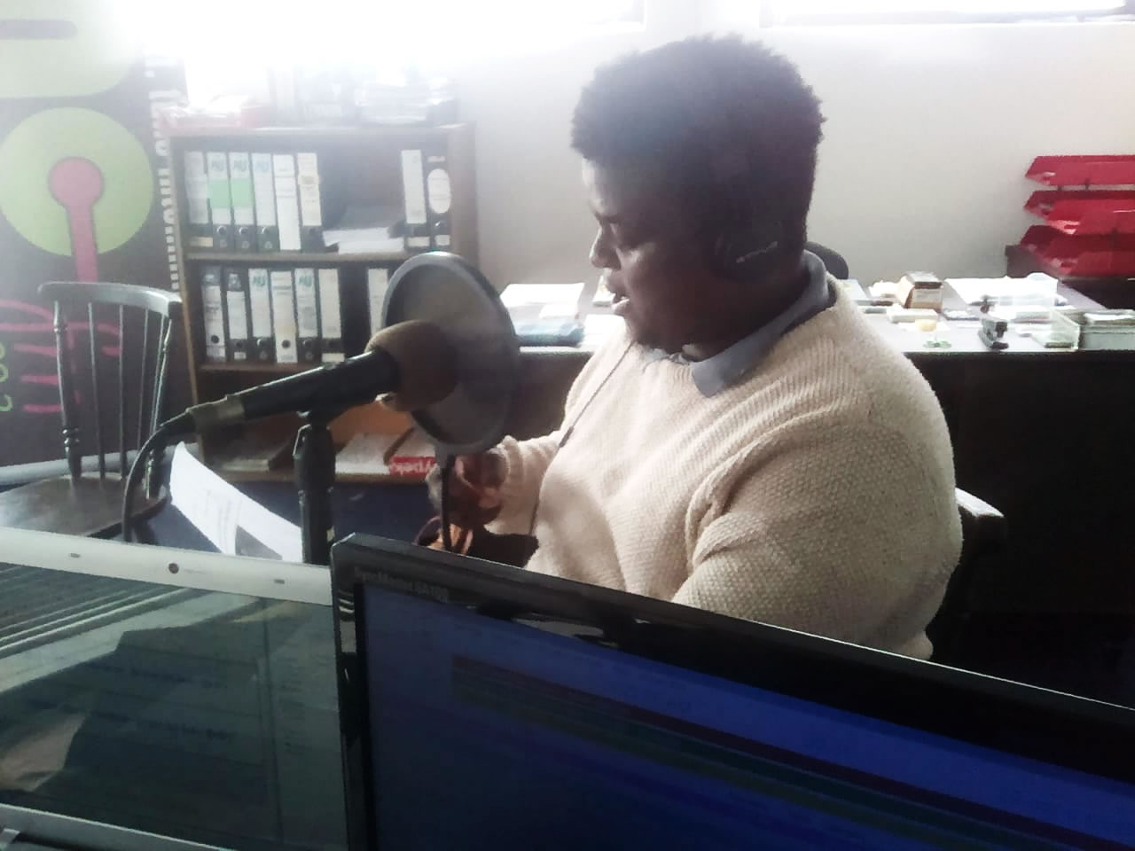 Wandisile Sebezo recording an episode of iKasi Life at MC Wave FM Radio Station in Plett