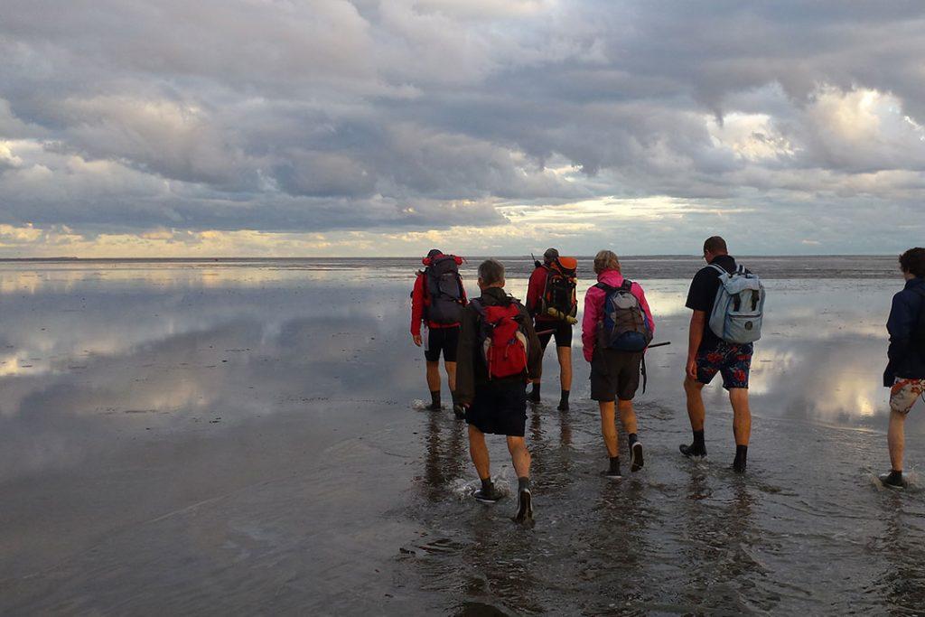 Group hiking beach