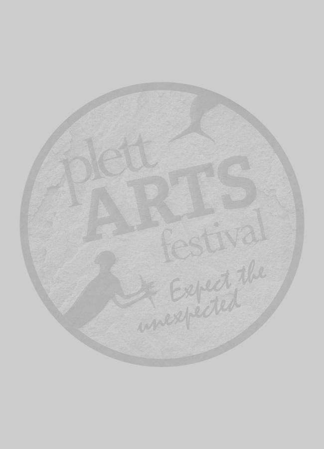 plett arts festival poster holding image