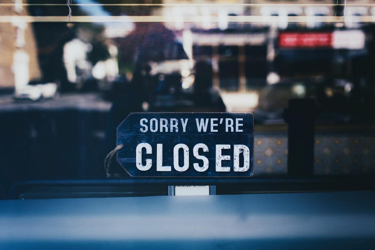 closed sign on window
